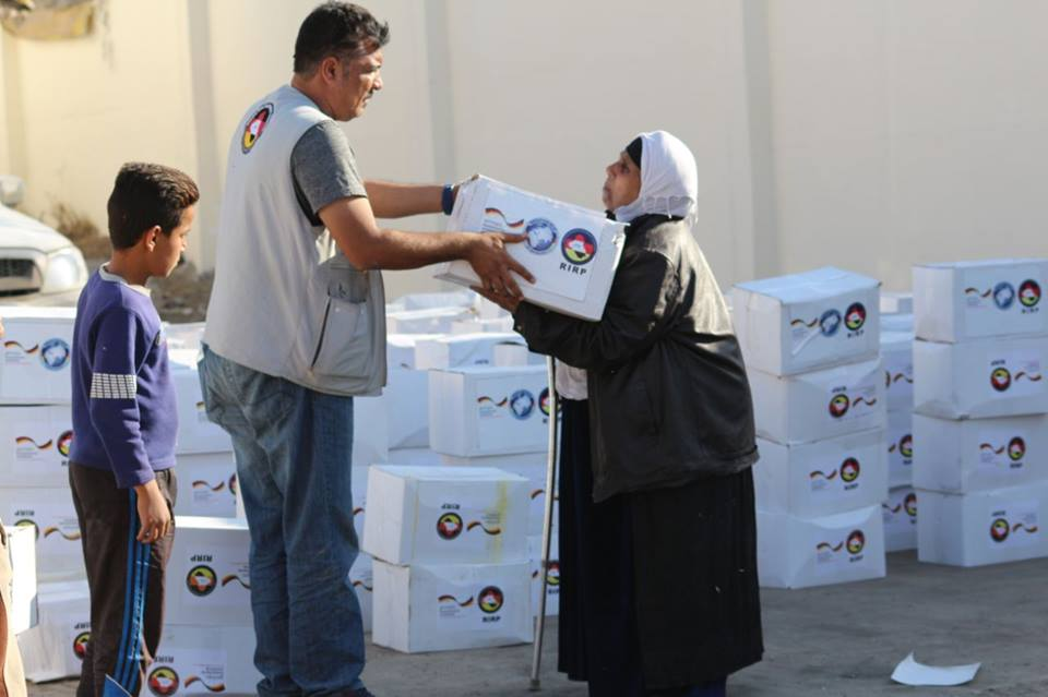Distribution of winter clothes in the orphanage's home in Al Adhamiya, Baghdad